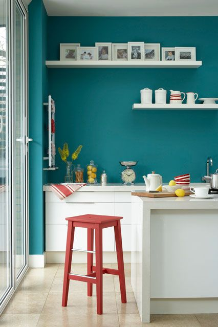 kitchen with bright teal walls at Easy Living