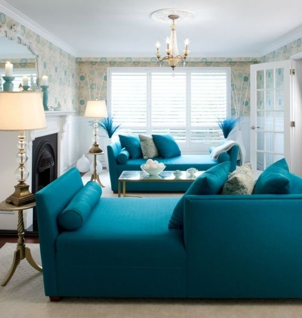 living room with bright teal sofas