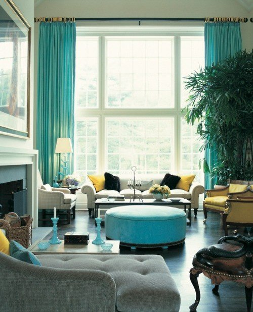 eclectic living room decor with light teal drapings