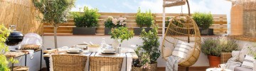 Beautifully decorated small terrace for relaxation and barbecue
